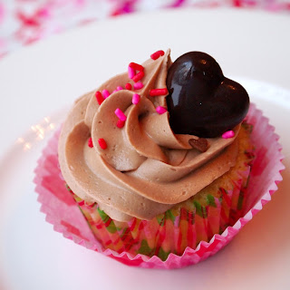 Raspberry Filled Vanilla Cupcakes with Real Milk Chocolate Buttercream..