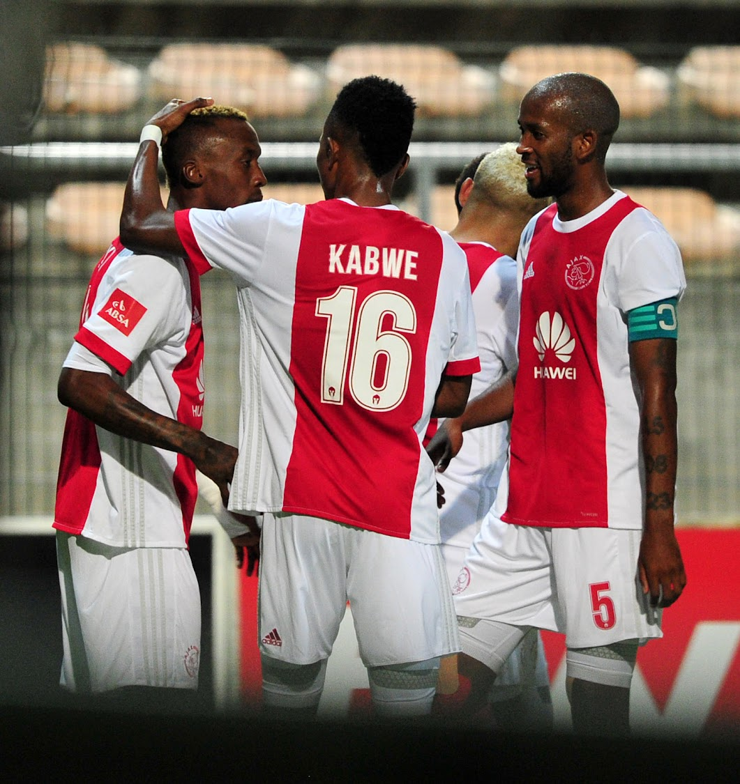 Ajax Cape Town striker (L) celebrates with teammates Roderick Kabwe and captain Mosa Lebusa (R) during the Absa Premiership match against Bidvest Wites at Athlone Stadium, Cape Town on 11 April 2018. Ajax won 1 - 0.