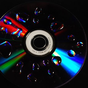 CD vs Water by Nikos Pilpilidis - Products & Objects Technology Objects ( water, reflection, color, cd )