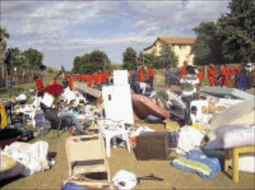 SURPRISE EVICTION: The Red Ants raided several flats in Mmabatho early yesterday morning and forcefully evicted tenats who have resisting eviction since last week. Pic. Elisha Molefe. 29/10/2008. © Sowetan