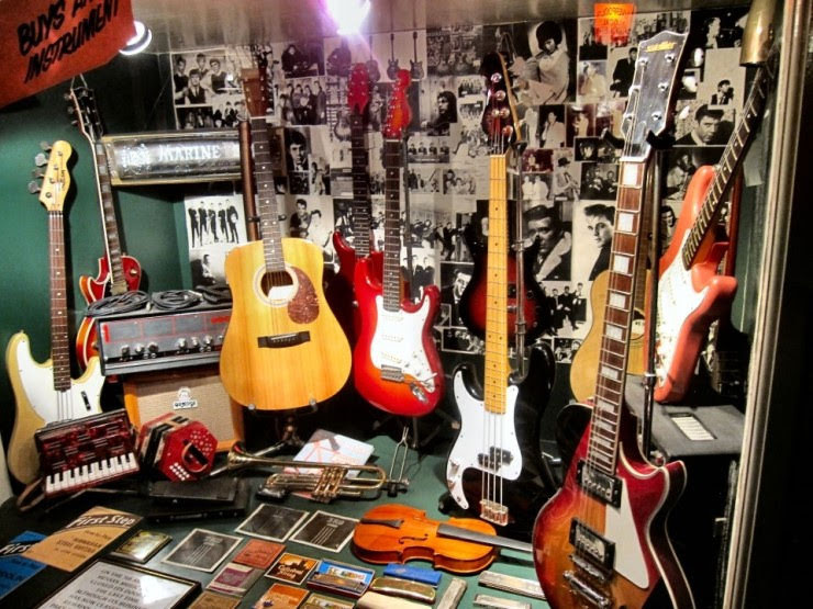 Replica_of_music_store_front_window_where_the_Beatles_bought_their_first_instrum.jpg