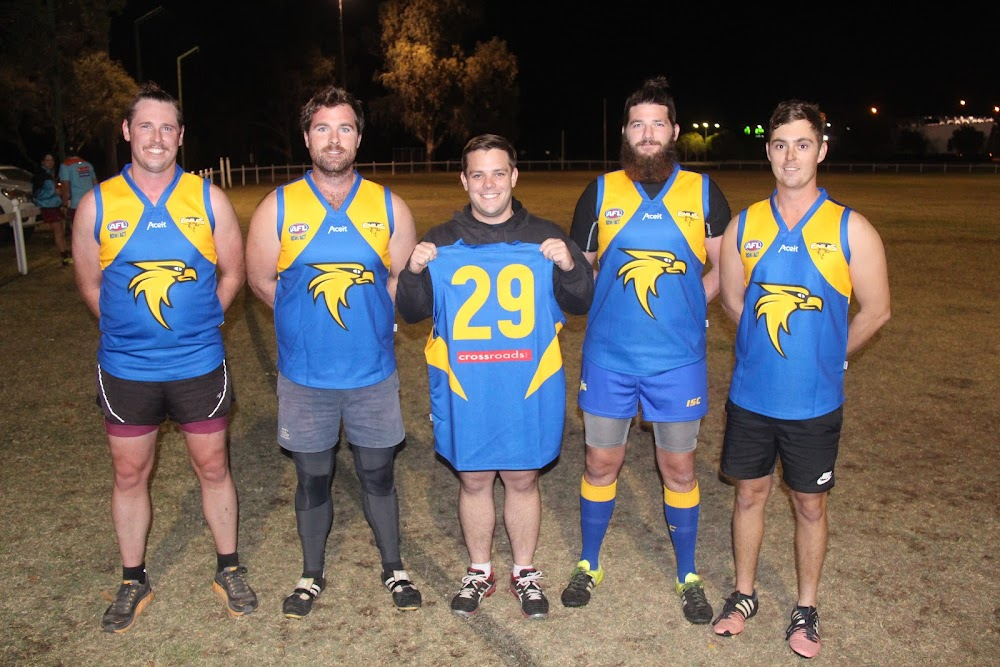 President Ben Maddern, midfield leader Dan Nixon, captain Luke McDermott, vice-captain Ciaran McCann and forward leader Tom Carberry show off the Eagles' new guernseys on Tuesday night at training.