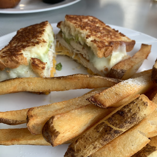 Grilled chicken guacamole melt with French fries