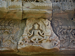 Photo: carved stone deity above doorway, Phimai
