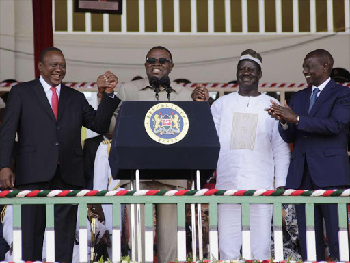Namibian President Hage Geingob(2nd left) holds hands with President Uhuru Kenyatta(L), Raila Odinga(2nd R) and Deputy President William Ruto at Bukgungu stadium in Kakamega County during the Mashujaa day celebrations on 20th October 2018