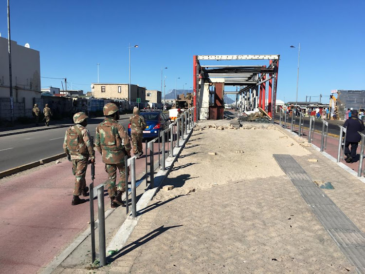 Soldiers near a vandalised bus station in Dunoon.