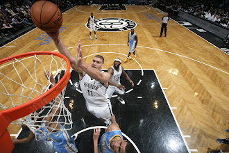 Photo: Brook Lopez #11 of the Brooklyn Nets goes up for the easy basket against the Denver Nuggets at the Barclays Center on February 13, 2013 in Brooklyn, NY.
