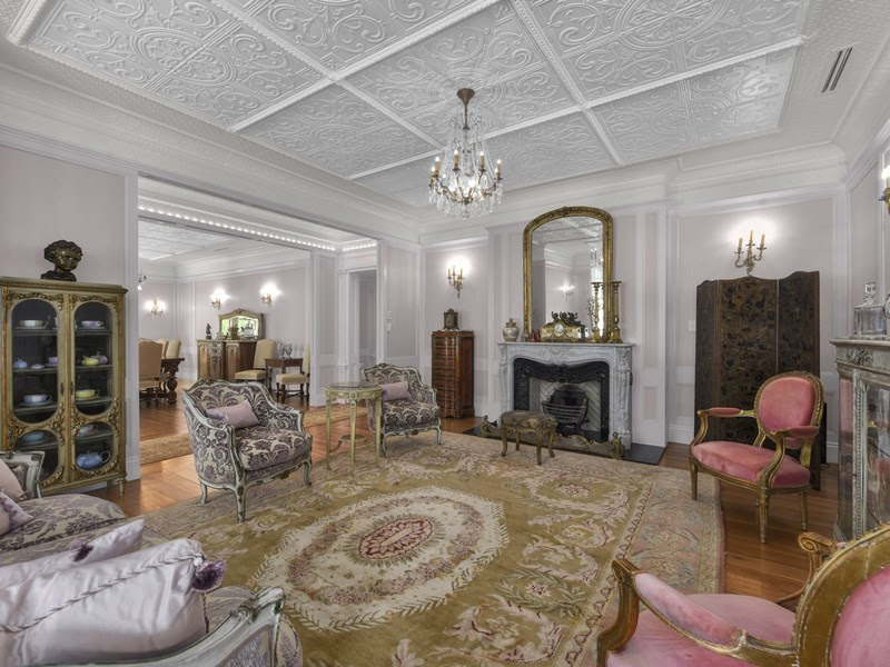 The decorative pressed metal high ceilings of this restored Queenslander