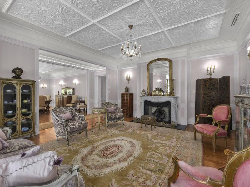 The decorative pressed metal high ceilings of this restored Queenslander