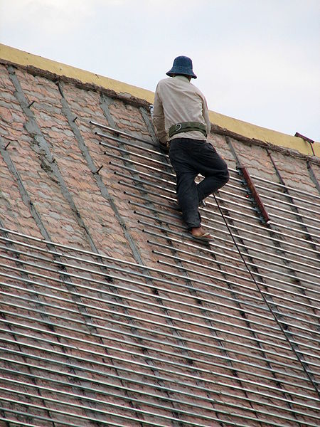 File:Worker fixing the roof of building in Royal Palace Cambodia.jpg