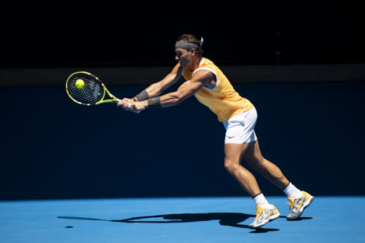 Rafael Nadal of Spain hits a backhand in his first round match against James Duckworth of Australia during day one of the 2019 Australian Open at Melbourne Park on January 14, 2019 in Melbourne, Australia.