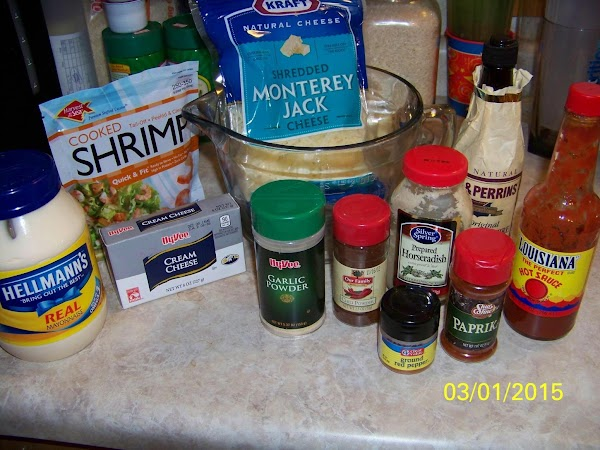 Gather all of the ingredients and then finely chop shrimp, onions and celery