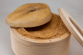 Photo: Bill Long - plywood jam chuck with sawdust and titebond.  Tulipwood bowl.