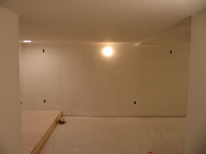 Photo: Entrance... primer/texture applied to walls.