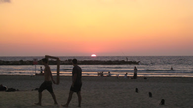 Photo: Sunset behind volleyball players in Tel Aviv