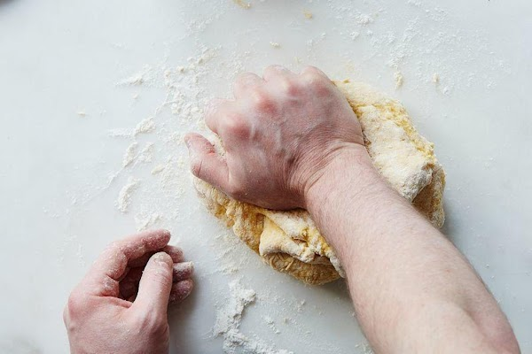 Knead the dough and add flour as necessary until the dough is no longer...