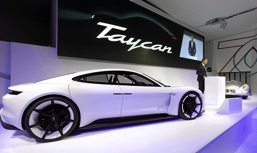 Porsche CEO Oliver Blume reveals the Taycan name for the Mission E electric sports car. Picture: PORSCHE