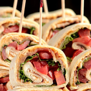 Tuscan Herb Hummus, Prosciutto and Goat Cheese Pinwheels