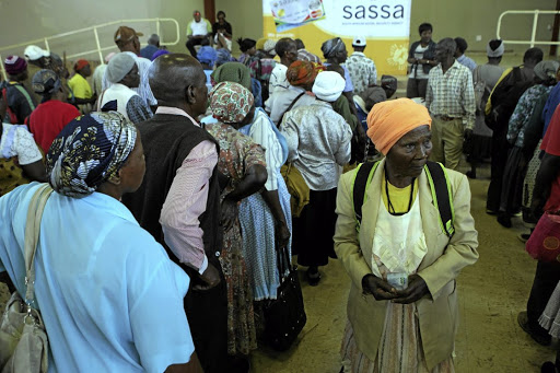 A pensioner leaves a paypoint after receiving her Sassa grant. Picture: SOWETAN