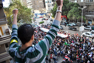 Photo: A youth leads the protesters in chants against SCAF