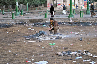 Photo: One of the inhabitants of the Tahrir Square occupation outside the 'Mugama' government building sits over the ashes of his tent, which was burnt to the ground by the army after an attack.