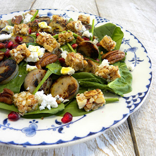 Spinach Salad with Pomegranate and Granola Bar Crumble.