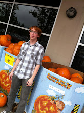 Photo: Look! His hair is the same color as the pumpkins!
