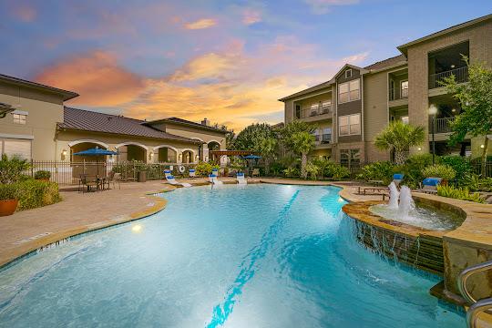 Resort-style swimming pool at dusk