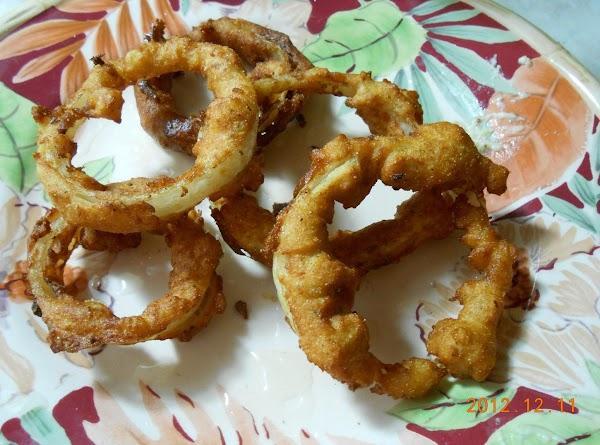 Fry onion rings in EVOO till brown.