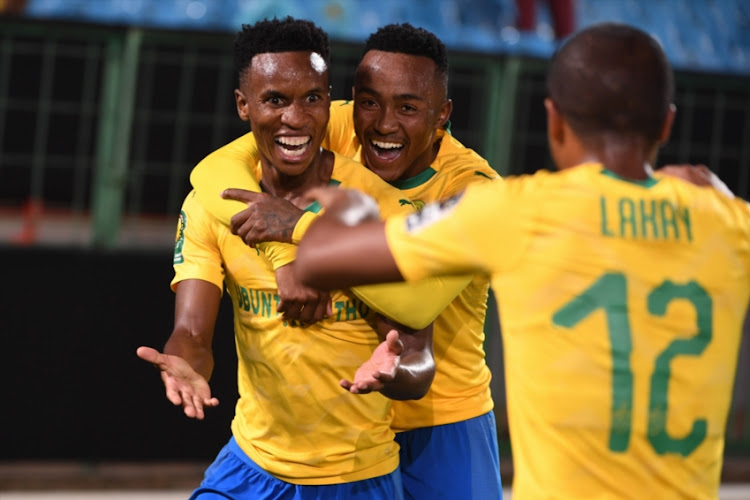 Thema Zwane of Mamelodi Sundowns celebrates his goal with his team mates during the CAF Champions League match between Mamelodi Sundowns and ASEC Mimosas at Lucas Moripe Stadium on February 01, 2019 in Pretoria, South Africa.
