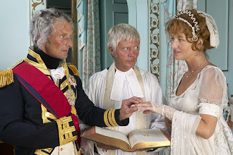 Photo: Nelson and emma , with the rev lancaster, vicar of merton, exchange rings on the eve of the battle of trafalgar