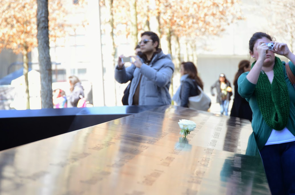 Visitors to National September 11 Memorial & Museum taking pictures