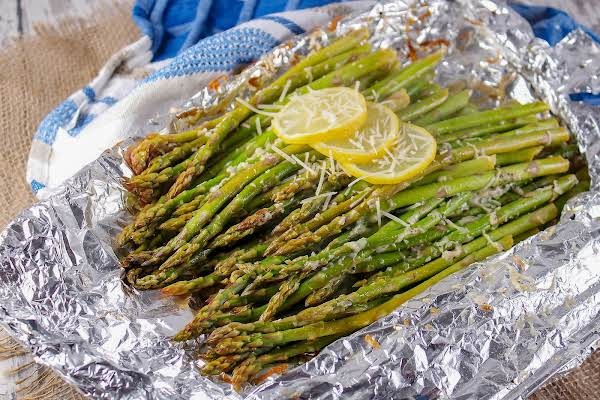 Bbq Asparagus On Aluminum Foil With Lemon Slices.