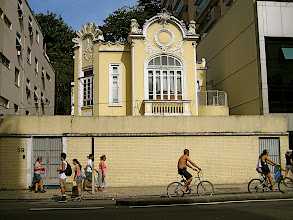 Photo: Ornate but dilapidated building surrounded by ugly modern block houses.  Rio de Janeiro.