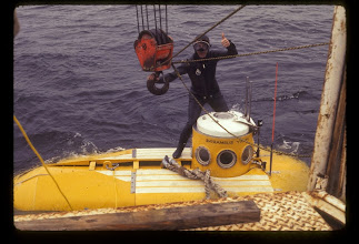Photo: Support swimmer assists in launching the Perry PC-8 submersible (Photo Credit: R. Cooper/NOAA)