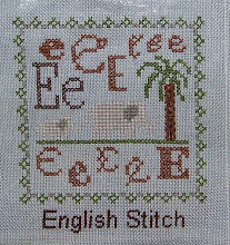 "Photo: Completed 26 March 2010. Sampler Book ""E"" (2006) by Erica Michaels stitched on Antique Blue 32ct linen. The stitching was done in Needle Necessities silks. Stitch count: 53w x 60h."
