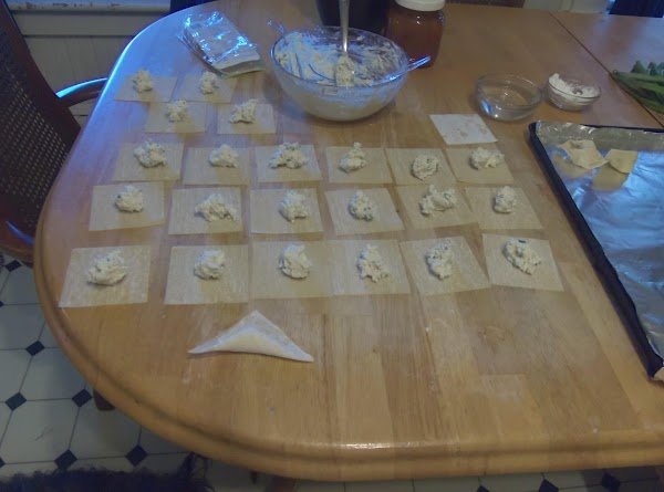 With your fingertips wet 1/2 of the wonton and fold the other half over...