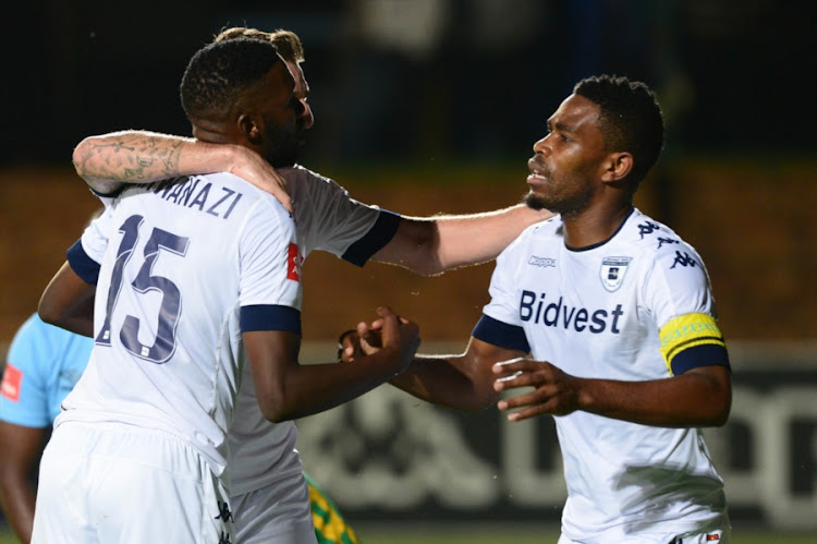 Buhle Mkhwanazi, James Keene and Thulani Hlatshwayo of Wits celebrate a goal during the Absa Premiership match between Bidvest Wits and Baroka FC at Bidvest Stadium on February 22, 2017 in Johannesburg, South Africa.