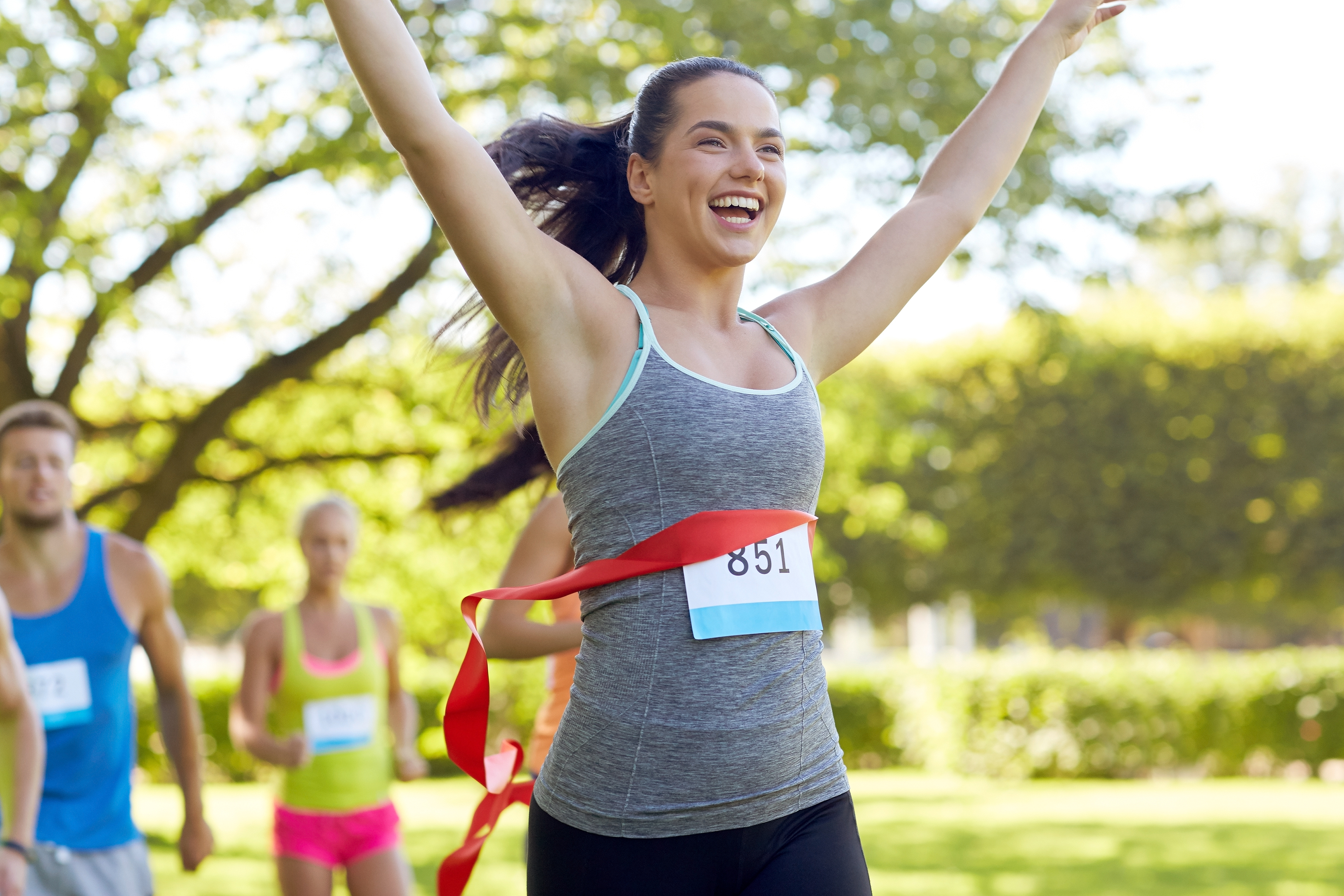 Excited woman crossing finish line
