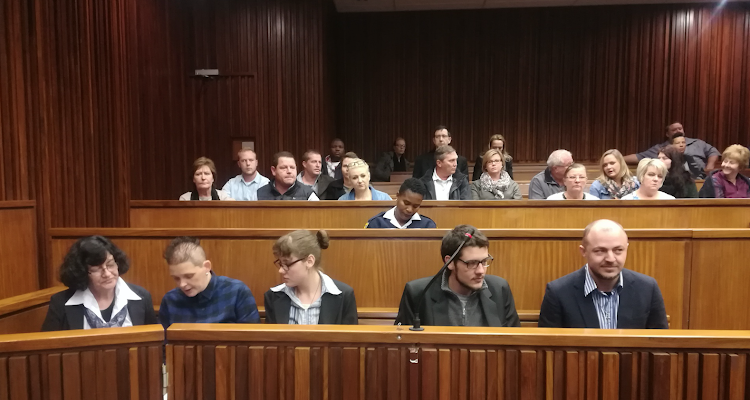 Krugersdorp murder accused in the dock are, from left to right, Marinda Steyn, Cecilia Steyn (no relation), Marcel and Leroux Steyn (Marinda's children) and Zak Valentine