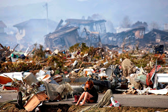 Photo: A woman cries while sitting on a road amid the destroyed city of Natori, Miyagi Prefecture in northern Japan March 13, 2011, after a massive earthquake and tsunami that are feared to have killed more than 10,000 people. Picture taken March 13, 2011.  REUTERS/Asahi Shimbun (JAPAN - Tags: DISASTER ENVIRONMENT IMAGES OF THE DAY) JAPAN OUT. NO COMMERCIAL OR EDITORIAL SALES IN JAPAN. FOR EDITORIAL USE ONLY. NOT FOR SALE FOR MARKETING OR ADVERTISING CAMPAIGNS. THIS IMAGE HAS BEEN SUPPLIED BY A THIRD PARTY. IT IS DISTRIBUTED, EXACTLY AS RECEIVED BY REUTERS, AS A SERVICE TO CLIENTS