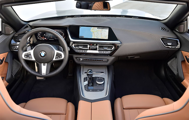 The interior blends style with tech.