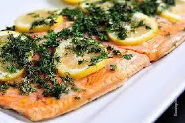 Remove the salmon and place on warmed plates. Garnish with green olives and lemon...