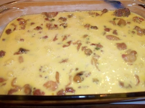 In a greased 9x13 inch pan, spread the meat mixture. Pour the egg mixture...