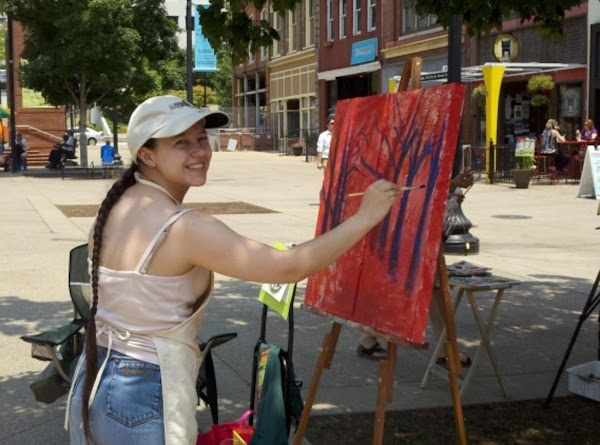 Here is DeLena beginning her painting on Friday in Market Square.