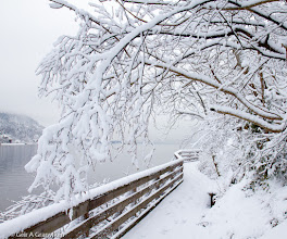 Photo: A foot bridge taking you around a steep mountain wall on a trail in Hyggen