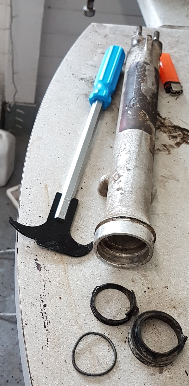Oil real removal tool being used on the fork legs.