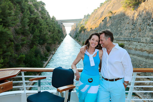 Seadream-corinth-couple.jpg - Traverse the world, and sail through the Corinth Canal, on a SeaDream Yacht Club cruise.