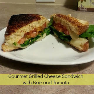 Gourmet Grilled Cheese Sandwich with Brie and Tomato.