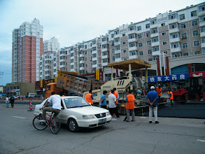 Photo: road expanding in QRRS area, eastern Qiqihar. gas pipe landing also in progress. large machines attracted watchers.